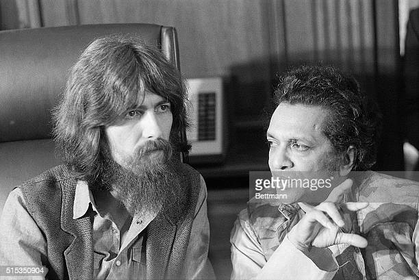 New York, New York- Former Beatle George Harrison and Indian musician Ravi Shankar talk to newsmen here 7/27 about a concert they and other muscians...