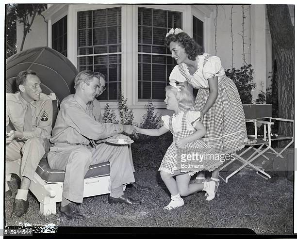 7/27/44Brentwood California At her home in Brentwood California charming movie actress Joan Crawford introduces her adopted daughter Christina to...