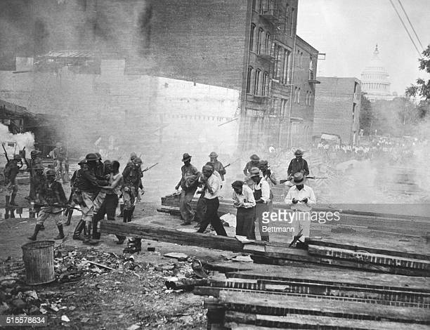 Washington, DC: Bonus Army; Veterans dispersed by soldiers with tear gas, July 28, 1932. Washington, DC. Photograph.