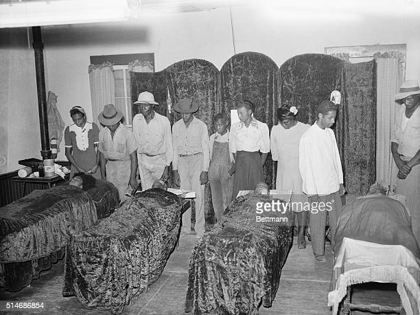 Friends and relatives of Mr and Mrs George Dorsey and Mr and Mrs Roger Malcom Negroes pay their respects to the four in a funeral parlor here The...