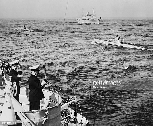 7/28/39Bremerhaven Germany Adm Erich Raeder of the German navy waving his baton approvingly as the long line of new German submarines passes by in...