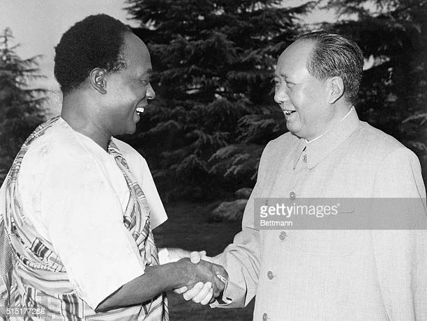 Hangchow, China: Symbolizing Red China's eagerness to win new friends in Africa, Mao Tse-Tung extends the hand of friendship to Ghana's President...