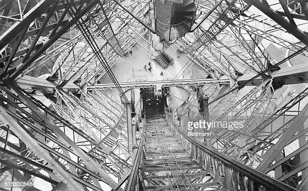 7/29/1924Paris France Thirty tons of paint are being used in the repainting of the Eiffel Tower and now workmen are now nearly finished with this...