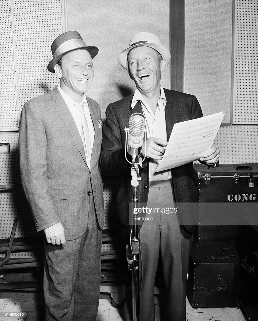 Recording history is made as Frank Sinatra (L) and Bing Crosby cut their first record together for Sinatra's Reprise Records. Der Bingle joined Sinatra and Dean Martin singing 'The Oldest Established Permanent Floating Crap Game in New York,' for a new 'Guys and Dolls' album.