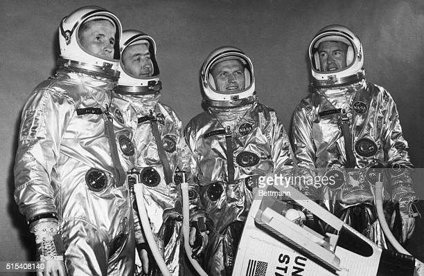 7/29/1964Houston TXThe primary and backup astronaut crews for the second manned Gemini flight next spring pose in their space suits with a model of...
