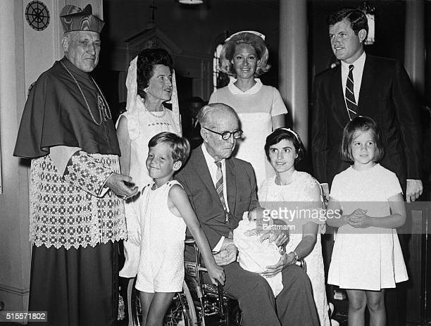 7/29/1967Hyannis Mass Patrick Joseph Kennedy is held by godparents Joseph P Kennedy and Ann Gargan following christening at ST Francis Xavier Church...