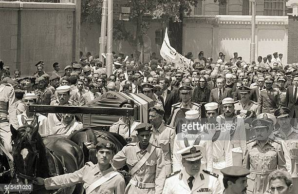 7/29/1980Cairo Egypt The horsedrawn caisson bearing the body of the exShah of Iran is followed by the Shah's widow the former Empress Farah Diba the...