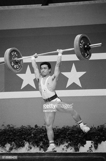 Los Angeles, CA: Japan's Kazuhito Manabe lifts on one foot on his way to a bronze medal in the 52 Kg class weightlifting in the 1984 Olympics in Los...