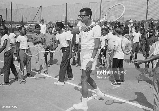 7/29/68Washington DC Arthur Ashe the nation's secondranked amateur displays his winning form to a group of Washington youngsters during one of eight...