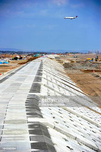 A 72m high bank rebuilt after it was hit by undertow in March 2011 Earthquake at Sendai Airport on March 23 2013 in Iwanuma Miyagi Japan Ministry of...