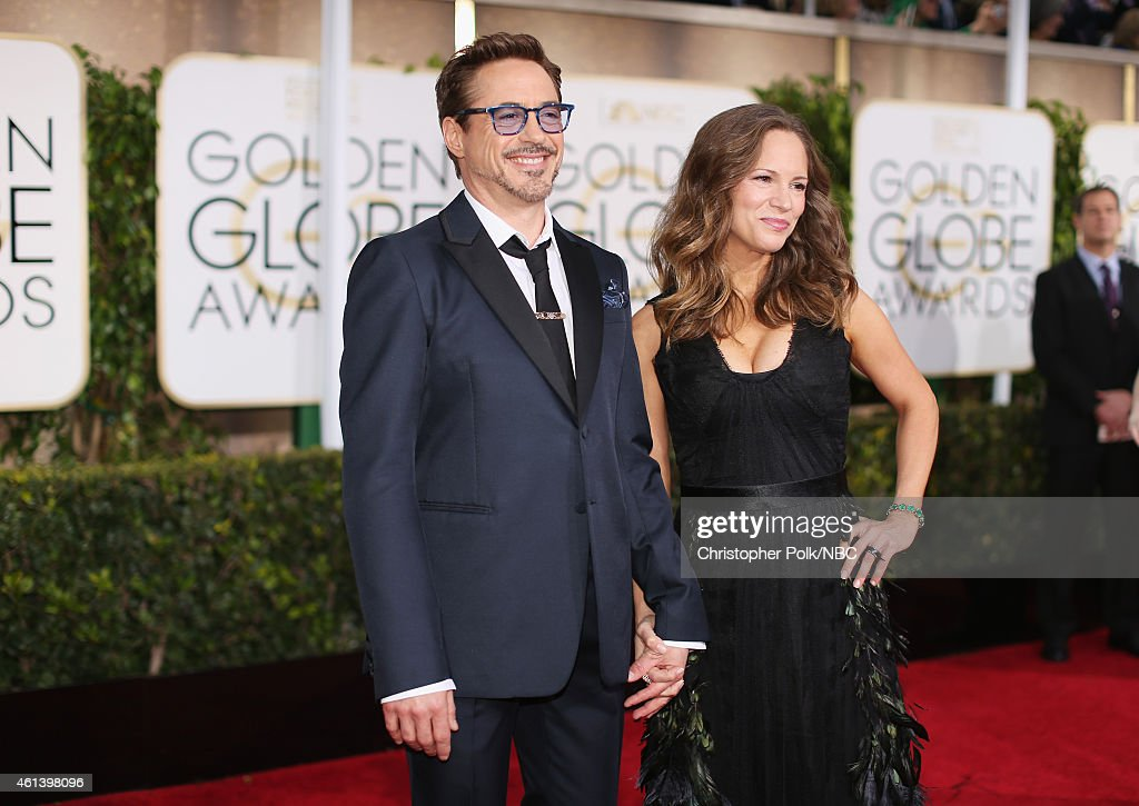 72nd ANNUAL GOLDEN GLOBE AWARDS -- Pictured: (l-r) Actor Robert Downey Jr. and producer Susan Downey arrive to the 72nd Annual Golden Globe Awards held at the Beverly Hilton Hotel on January 11, 2015.