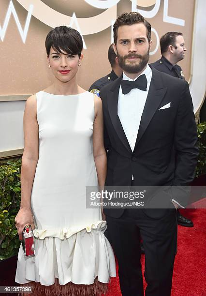 72nd ANNUAL GOLDEN GLOBE AWARDS Pictured Actors Amelia Warner and Jamie Dornan arrive to the 72nd Annual Golden Globe Awards held at the Beverly...