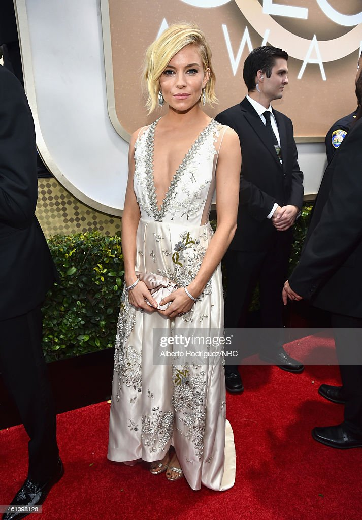 72nd ANNUAL GOLDEN GLOBE AWARDS -- Pictured: Actress Sienna Miller arrives to the 72nd Annual Golden Globe Awards held at the Beverly Hilton Hotel on January 11, 2015.