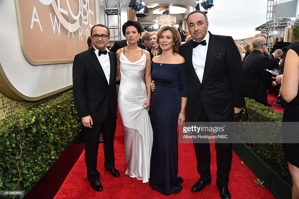 72nd ANNUAL GOLDEN GLOBE AWARDS -- Pictured: (l-r) Andrey Zvyagintsev, guests, and Alexander Rodnyansky arrive to the 72nd Annual Golden Globe Awards held at the Beverly Hilton Hotel on January 11, 2015.