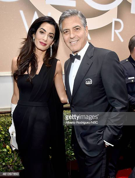 72nd ANNUAL GOLDEN GLOBE AWARDS Pictured Lawyer Amal Clooney and actor George Clooney arrive to the 72nd Annual Golden Globe Awards held at the...