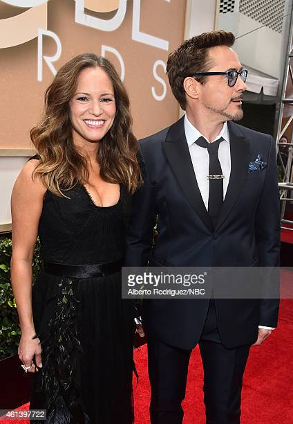72nd ANNUAL GOLDEN GLOBE AWARDS Pictured Producer Susan Downey and actor Robert Downey Jr arrive to the 72nd Annual Golden Globe Awards held at the...