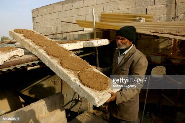 72yearold Pakistani man Mahmoud Fadil Ekrem who was isolated at Syrias Eastern Ghouta which is under blockade by Assad regime prepares animal dung...