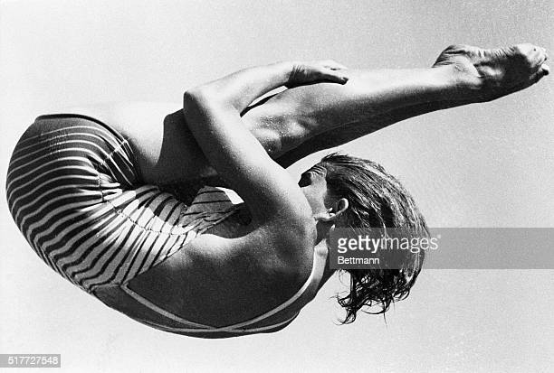7/30/1952Helsinki Finland OLYMPICS GAMES Mrs Patricia McCormick of Los Angeles CA shows off her championship form as she executes a difficult...