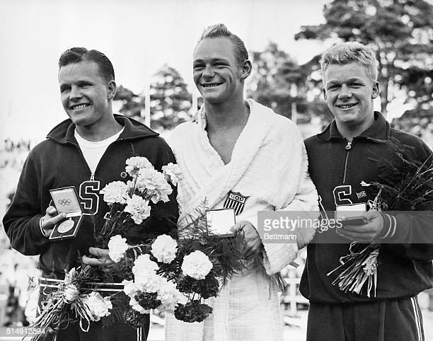 7/30/1952Helsinki Finland Shown here with their medals and bouquets after the finals of the Men's Springboard Diving at the Olympic Swimming Pool are...