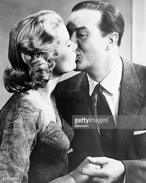 7/30/1954Hand holding and a polite peck with Ray Milland were combined with a locut gown in Dial M For Murder Grace's third film with an Academy...