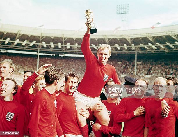 England captain Bobby Moore chaired by his team with the Jules Rimet Cupafter receiving it from the Queen after England won the Cup final 4 goals to...