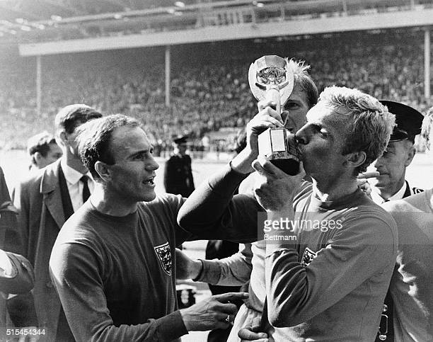 Wembley, England-: England's Bobby Moore kisses the Jules Rimet Cup following his team's defeat of West Germany in the World Cup Soccer Championship...
