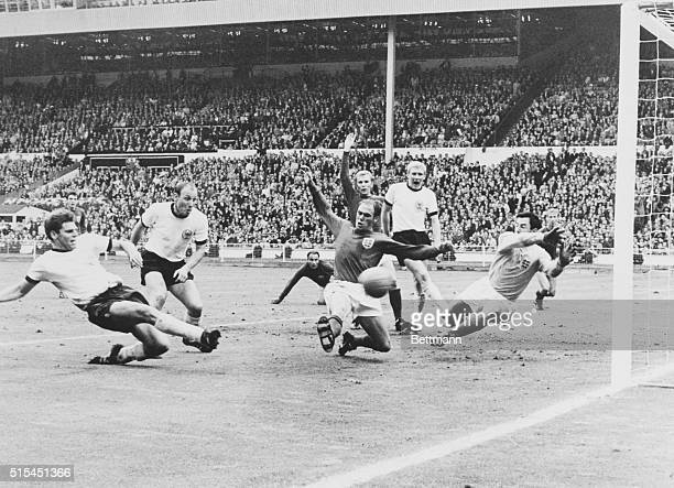 Wembley, England-ORIGINAL CAPTION READS: Wolfgang Weber of West Germany scores his team's second goal as England's Ray Wilson and goalie Gordon Banks...