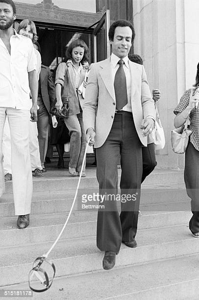 7/30/1979Oakland CA Black Panther cofounder Huey Newton leaves Alameda County Courthouse with a batteryoperated leash connected to a hovering dog...