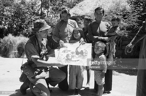 7/30/66Loc Thuong S Vietnam Pulitzer Prizewinning Japanese war photographer Kyoichi Sawada of UPI presents his prizewinning print of Vietnamese...