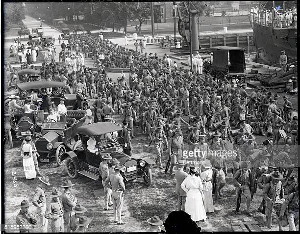 7/31/1915Philadelphia PA Marines are shown marching from the barracks of the League Island Navy Yard in Philadelphia to board the U S S Conneticut...