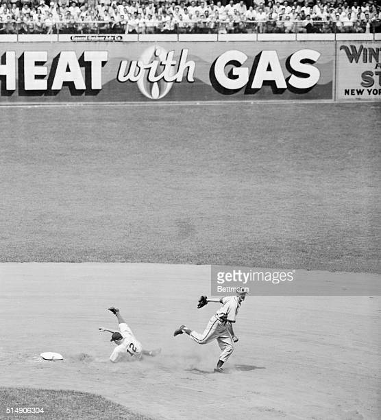 Brooklyn, NY: Dodger Ed Stanky flops in a heap after being forced out at second base in the first inning of the game with the St. Louis Cardinals at...