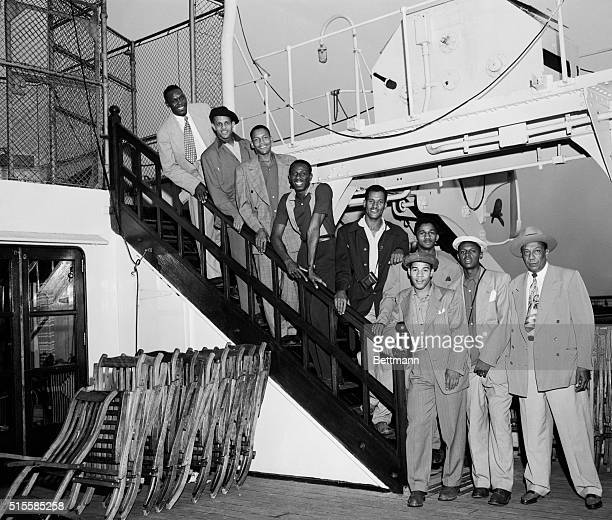 7/31/1950New York NY Members of the Globetrotters basketball team are shown arriving in New York aboard the liner Mauretania From top to bottom are...