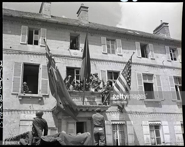7/3/1944Cherbourg France The French tricolor is flanked by the British and American flags on the Cherbourg Hotel De Ville following the liberation of...