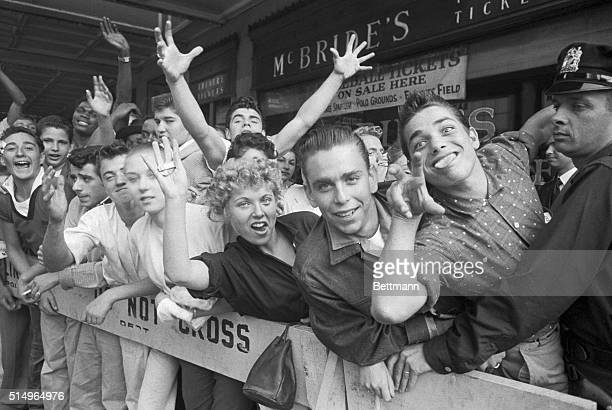 7/3/1957New York NY All shook up even before the show begins excited teenagers are kept in line by police barricades outside the Paramount Theater...