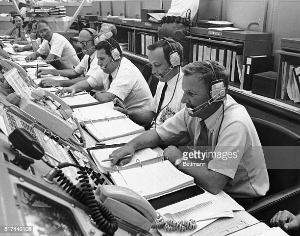 Kennedy Space Center, Cape Kennedy, Florida- Apollo 11 space vehicle supervisor, Bill Schick , coordinates CDDT within LCC Firing Room 1. Others...