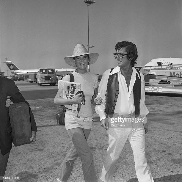American film star Ali McGraw costar of the popular movie Love Story is all smiles as she and hubby Robert Evans stroll at the Rome airport here July...