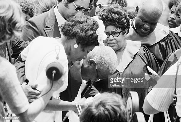 Rev Martin Luther King Sr doubles over faint at the graveside of his slain wife Alberta Comforting Reverend King is his daughter Christine Alberta...