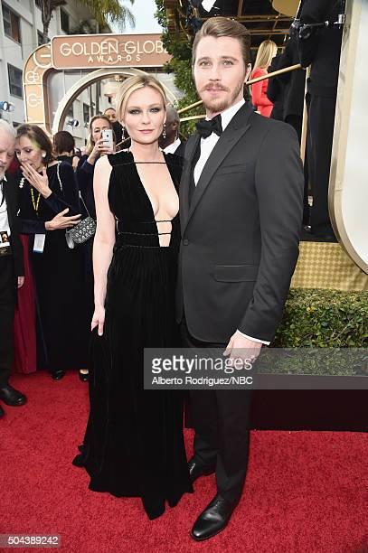 73rd ANNUAL GOLDEN GLOBE AWARDS -- Pictured: Actress Kirsten Dunst and actor Garrett Hedlund arrive to the 73rd Annual Golden Globe Awards held at...
