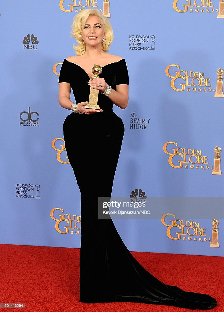 73rd ANNUAL GOLDEN GLOBE AWARDS -- Pictured: Singer/actress Lady Gaga, winner of the award for Best Performance by an Actress in a Mini-Series or a Motion Picture Made for Television for 'American Horror Story', poses in the press room at the 73rd Annual Golden Globe Awards held at the Beverly Hilton Hotel on January 10, 2016.