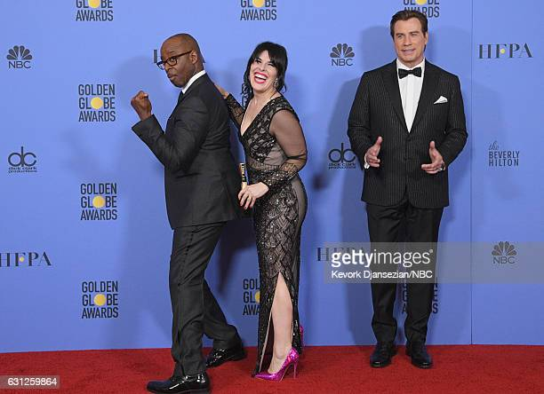 74th ANNUAL GOLDEN GLOBE AWARDS Pictured Actor Courtney B Vance producer Alexis Martin Woodall and actor John Travolta pose in the press room at the...