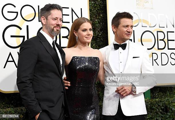 74th ANNUAL GOLDEN GLOBE AWARDS Pictured Actors Darren Le Gallo Amy Adams and Jeremy Renner arrive to the 74th Annual Golden Globe Awards held at the...
