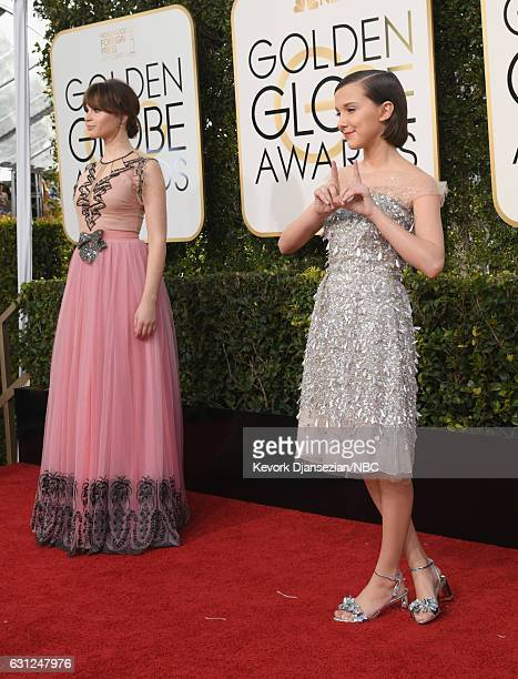 74th ANNUAL GOLDEN GLOBE AWARDS Pictured Actors Felicity Jones and Millie Bobby Brown arrive to the 74th Annual Golden Globe Awards held at the...