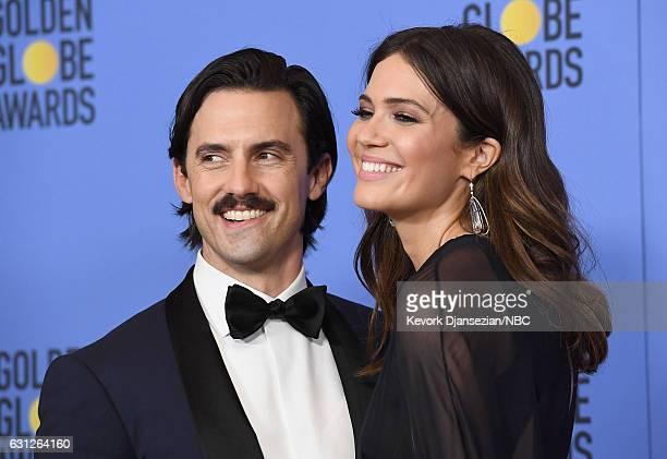 74th ANNUAL GOLDEN GLOBE AWARDS Pictured Actors Milo Ventimiglia and Mandy Moore pose in the press room at the 74th Annual Golden Globe Awards held...