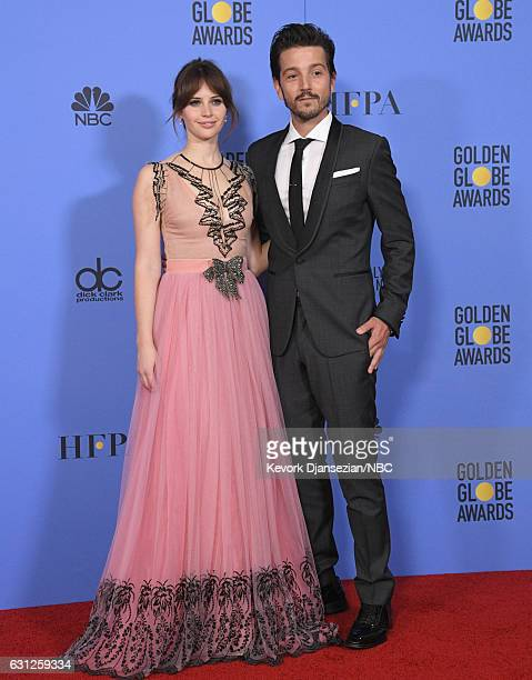 74th ANNUAL GOLDEN GLOBE AWARDS -- Pictured: Actos Felicity Jones and Diego Luna pose in the press room at the 74th Annual Golden Globe Awards held...