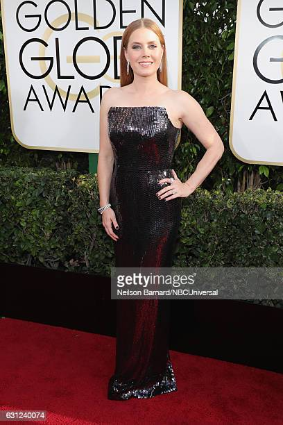 74th ANNUAL GOLDEN GLOBE AWARDS Pictured Actress Amy Adams arrives to the 74th Annual Golden Globe Awards held at the Beverly Hilton Hotel on January...