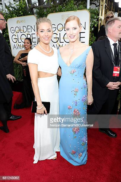 74th ANNUAL GOLDEN GLOBE AWARDS Pictured Actresses Sienna Miller and Jessica Chastain arrive to the 74th Annual Golden Globe Awards held at the...