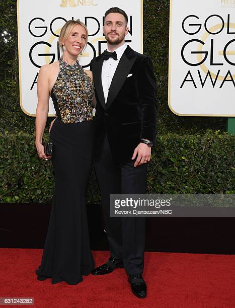 74th ANNUAL GOLDEN GLOBE AWARDS Pictured Director Sam TaylorJohnson and actor Aaron TaylorJohnson arrive to the 74th Annual Golden Globe Awards held...