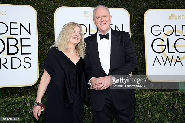 74th ANNUAL GOLDEN GLOBE AWARDS Pictured Mary Yeager and actor John Lithgow arrive to the 74th Annual Golden Globe Awards held at the Beverly Hilton...