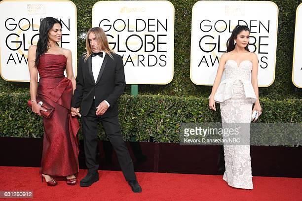 74th ANNUAL GOLDEN GLOBE AWARDS Pictured Nina Alu musician Iggy Pop and actress Praya Lundberg arrive to the 74th Annual Golden Globe Awards held at...