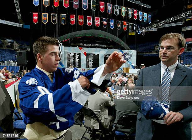 74th overall pick Dale Mitchell of the Toronto Maple Leafs puts on his new team jersey after being drafted in the 2007 NHL Entry Draft at Nationwide...